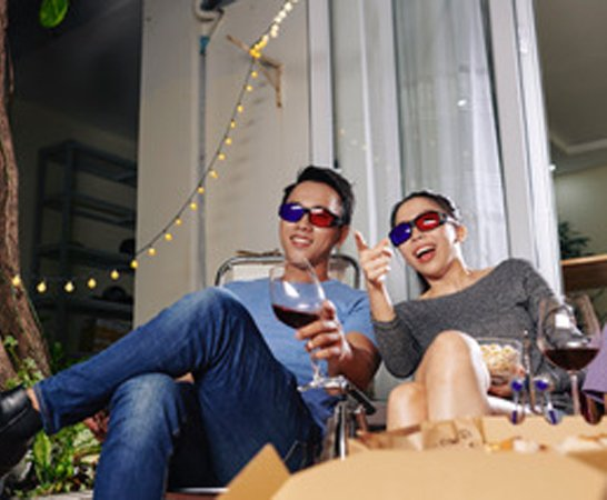 Couple watching a movie together in 3D