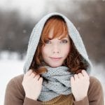 Woman protecting from winter static frizz with Fluoro5 Elixer